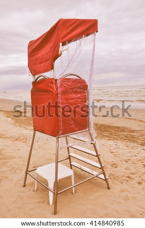 Vintage looking Lifeguard watch tower on the beach on the seaside - stock photo