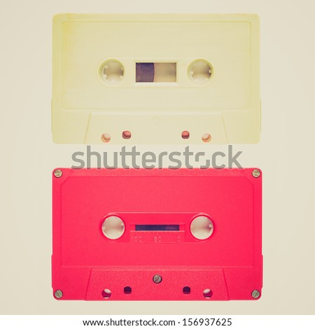 Vintage looking Magnetic tape cassette for audio music recording - isolated over white background - stock photo