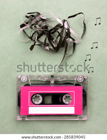 Vintage looking Magnetic tape cassette for audio music recording with song note blow out