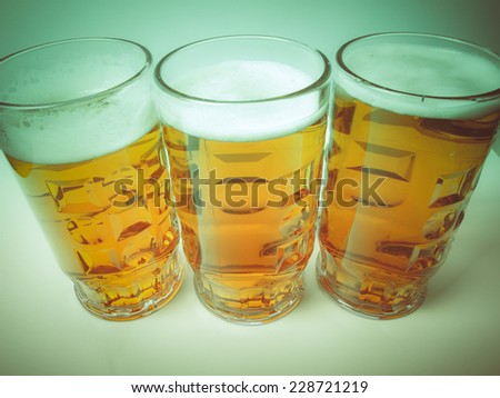 Vintage looking Many large glasses of German lager beer - stock photo