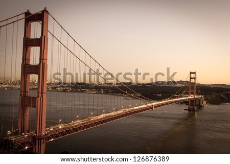 Vintage looking photo of the Golden gate bridge in sunset - stock photo