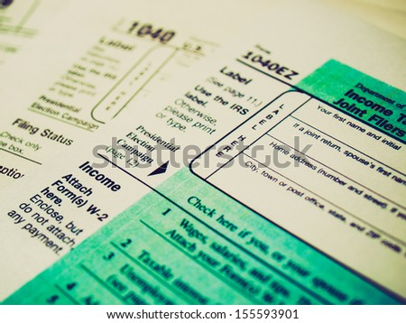 Vintage looking Range of various blank USA tax forms - stock photo
