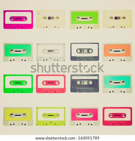 Vintage looking Set of magnetic tape cassette for audio music recording - isolated over white background - stock photo