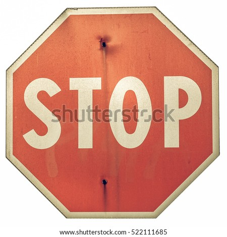 Vintage looking Stop traffic sign isolated on white background