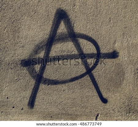 Vintage looking Symbol of Anarchy painted on a wall