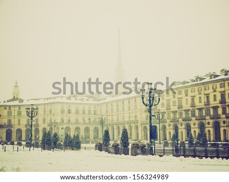 Vintage looking The Piazza Vittorio Emanuele II square in Turin Italy - winter view with snow - stock photo