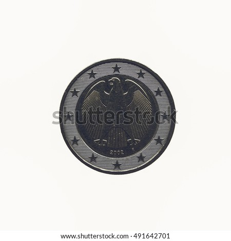 Vintage looking Two Euro coin isolated over a white background