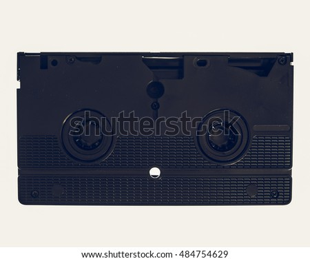 Vintage looking Vintage videotape VHS video cassette isolated over white