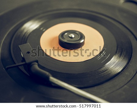 Vintage looking Vinyl record on a turntable record player, single 45rpm disc