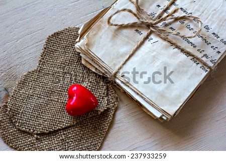 vintage love letters and hand made heard on old board - stock photo