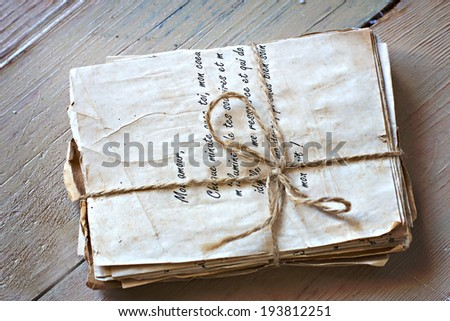 vintage love letters on old boards - stock photo