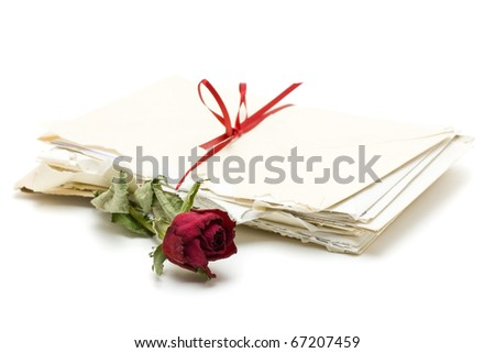 Vintage love letters with red rose over white background - stock photo