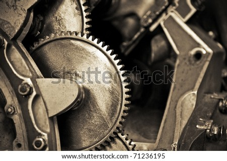 vintage machine cogwheels with shallow d.o.f - stock photo
