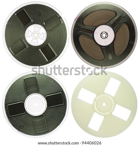 Vintage magnetic audio reels on a white background.