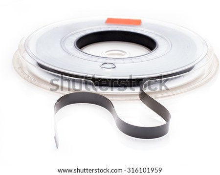 Vintage magnetic tape reel for computer data storage isolated on white background - stock photo