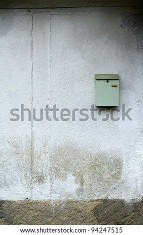 vintage mail box on damaged facade - stock photo