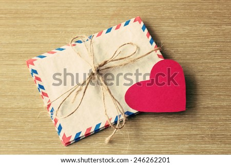 Vintage mail envelopes and paper heart - stock photo