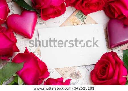 vintage mail with frame of  hearts and fresh roses - stock photo