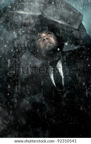 Vintage Man Wearing Bowler Hat Taking Shelter From A Thunder Storm Under A Newspaper In A Concept Of Media Problems, Bad Publicity And Unethical Journalism - stock photo