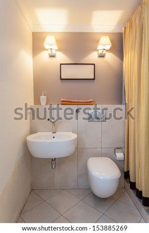 Vintage mansion - a small water closet with a sink - stock photo