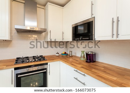 Vintage mansion - an oven with a cooker in a white kitchen - stock photo