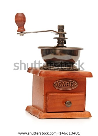 Vintage manual coffee grinder isolated on white