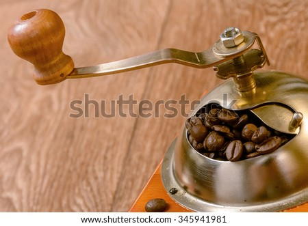 Vintage manual coffee grinder with beans. Retro coffee grinder