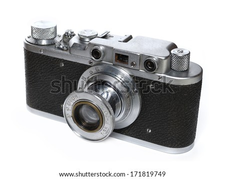 Vintage manual control film camera. Isolated on white. - stock photo