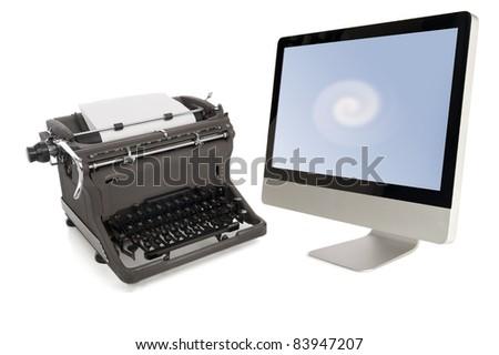 vintage manual typewriter and modern flat-panel monitor isolated on white background - stock photo