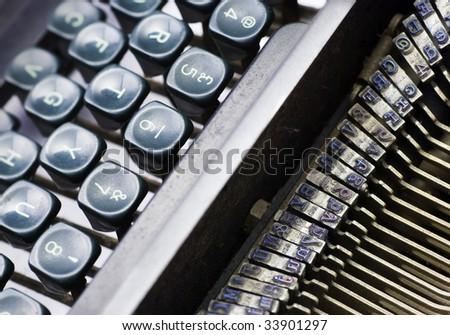 vintage manual typewriter showing keyboard and print-head area - stock photo