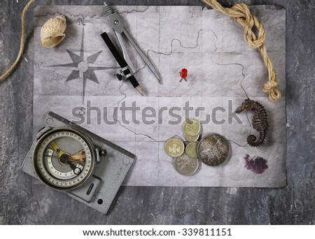 Vintage map and accessories for the treasure hunt and travel - stock photo