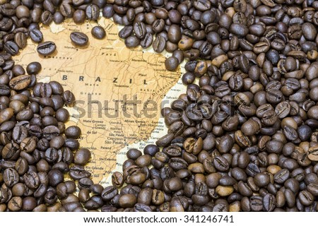 Vintage map of Brazil covered by a background of roasted coffee beans. This nation is the first main producer and exporter of coffee. Horizontal image.