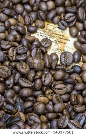Covered by a background of roasted coffee beans guatemala honduras