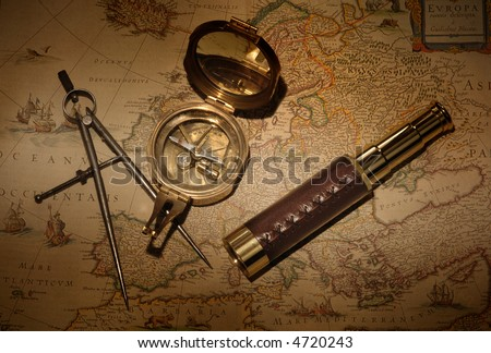 Vintage map with compass and telescope - stock photo