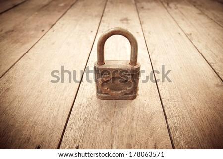 vintage master key on wood - stock photo