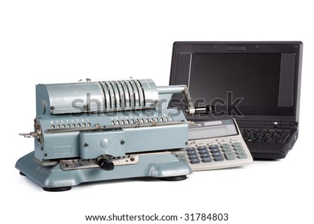 Vintage mechanical adding machine, modern calculator and notebook on a white background