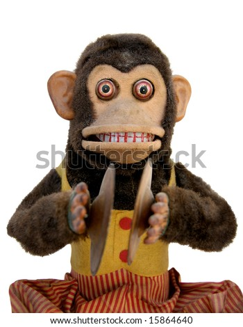 Vintage mechanical monkey toy with cymbal, upper body - stock photo