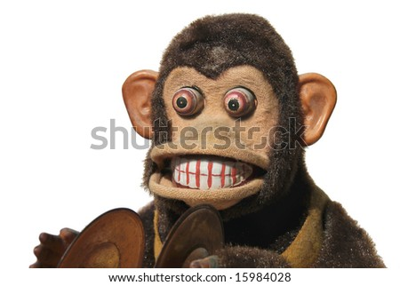 Vintage mechanical monkey toy with cymbals, close-up of face - stock photo
