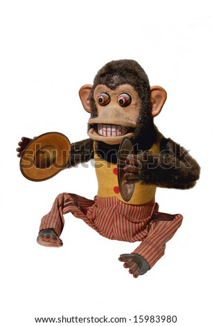 Vintage mechanical monkey toy with cymbals, full body isolation - stock photo