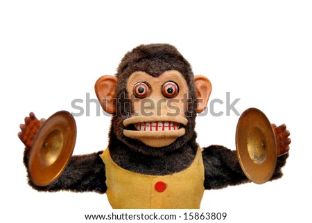Vintage mechanical monkey toy with cymbals, isolated on white - stock photo