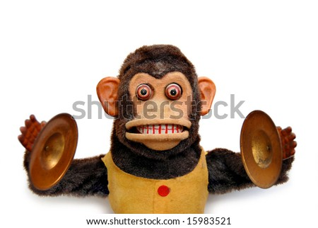 Vintage mechanical monkey toy with cymbals on white background