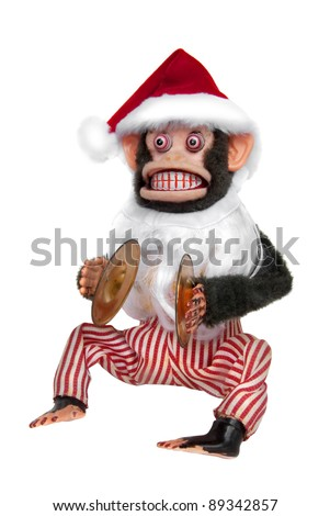 Vintage mechanical monkey toy with santa hat and beard - stock photo
