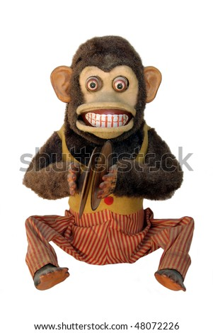Vintage mechanical monkey with toy cymbals showing teeth, full body isolated on white - stock photo