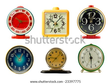 Vintage mechanical wind-up alarm clocks on white background - stock photo