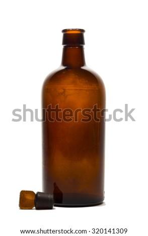 Vintage medical bottle of dark brown glass  - stock photo