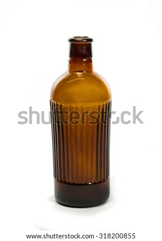 Vintage medical bottle of dark brown glass without lid - stock photo