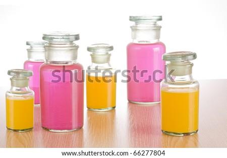 Vintage medicine bottles with medical liquid - stock photo