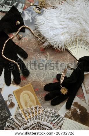 Vintage memories with old photos, gloves, fan and jewelry - stock photo