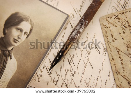 Vintage memories with woman portrait, pen and letters - stock photo