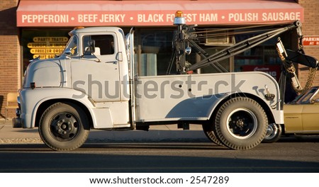 Vintage Mercury 600 tow truck. - stock photo